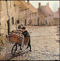 BNPS.co.uk (01202 558833)<br /> Pic: Hovis/BNPS<br /> <br /> A cottage immortalised in the famous Hovis TV advert featuring a young boy struggling to push his bike up a steep cobbled street is up for sale.<br /> <br /> The bungalow at Gold Hill, Shaftesbury, Dorset, was the home of 'Old Ma Peggotty' in the ad - the last house on the bakery boy's round.<br /> <br /> The 1973 commercial, directed by Ridley Scott, was voted Britain's all-time favourite TV advert in 2006.<br /> <br /> In it the lad is heard to say that delivering bread to the house on top of the hill 't'was like taking bread to the top of the world.'