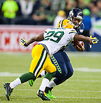 Seattle Seahawks quarterback Russell Wilson (3) is taken down by his face mask by Green Bay Packers cornerback Casey Hayward (29) during the fourth quarter of the NFL Kickoff held at CenturyLink Field September 4, 2014 in Seattle. Casey was flagged on the play. Wilson completed 19 passes for 191 yards, rushed for 29 yards as The Seahawks beat the Packers 36-16.    Seattle beat Green Bay 36-16. ©2014  Jim Bryant Photo. ALL RIGHTS RESERVED.