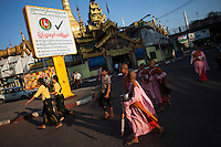Buddhist nuns pass an election poster, near a temple, for the government-backed USDP (Union Solidarity and Development Party) in the old capital Rangoon (Yangon) prior to Burma's first multi-party election since 1990. However, the main pro-democracy party, the NLD (National League for Democracy), boycotted the poll and other opposition groups have alleged widespread voting fraud.