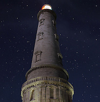 The Phare de Cordouan, or Cordouan Lighthouse, with light shining beneath a starry sky, built 1584-1611 in Renaissance style by Louis de Foix, 1530-1604, French architect, located 7km at sea, near the mouth of the Gironde estuary, Aquitaine, France. This is the oldest lighthouse in France. There are 4 storeys, with keeper apartments and an entrance hall, King's apartments, chapel, secondary lantern and the lantern at the top at 68m. Parabolic lamps and lenses were added in the 18th and 19th centuries. The lighthouse is listed as a historic monument. Picture by Manuel Cohen