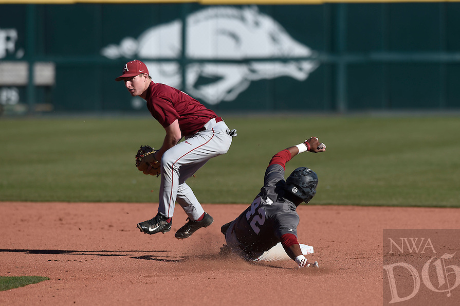 NWA Democrat-Gazette/MICHAEL WOODS @NWAMICHAELW<br /> University of Arkansas infielder Jax Biggers (9) forces out baserunner Jaxon Williams (42) Friday, January 27, during Razorback baseball teams first practice for the 2017 season at Baum Stadium.