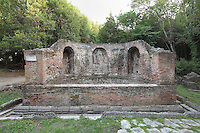 Roman Nymphaeum, a fountain dedicated to the nymphs, 2nd century AD, Butrint, Chaonia, Albania. The Nymphaeum is a brick structure with 3 niches and a basin. Butrint was founded by the Greek Chaonian tribe and was a port throughout Hellenistic and Roman times, when it was known as Buthrotum. It was ruled by the Byzantines and the Venetians and finally abandoned in the Middle Ages. The ruins at Butrint were listed as a UNESCO World Heritage Site in 1992. Picture by Manuel Cohen