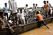 Local villagers cross the river Godavari river using the ferry boat in Valasaltippa village in East Godavari district of Andhra Pradesh, India.