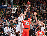 Notre Dame Fighting Irish guard Pat Connaughton (24) and Syracuse Orange forward James Southerland (43) fight for a second half rebound.