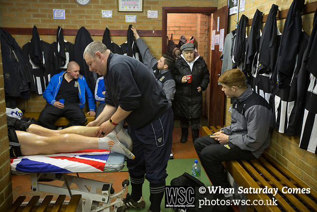 Tow Law Town 2 Heaton Stannington 2, 25.02.2014. Ironworks Road, Tow Law. A players receives a massage in the dressing room at the home of Tow Law Town, the Ironworks Road ground, before the club hosted Heaton Stannington in a Northern League division two fixture. It was the visitors first visit to Tow Law, having been promoted from the Northern Alliance last season. The match ended in a 2-2 draw, with the home team equalising in the last minute after having their goalkeeper sent off. Photo by Colin McPherson.
