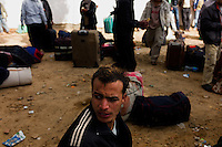 Ras Ajdir, Feb 25, 2011.Over 25000 refugees, mostly Egyptians and Libyans crossed the Tunisian border on Friday, to flee the ongoing revolution and bloody fights inside Libya.