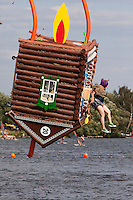 Moscow Russia, 07/08/2011..A contestant and her aircraft in the shape of a wooden dacha tumble toward the river at Red Bull Flugtag, when some 100,000 people gathered to watch a variety of homemade makeshift aircraft launched over and into the Moscow river.