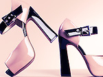 Thick heel open-toe platform shoes still life isolated on pink background