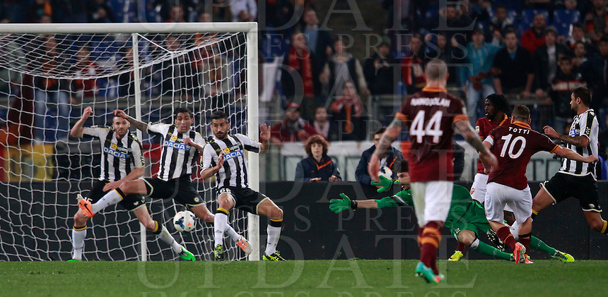 Calcio, Serie A: Roma vs Udinese. Roma, stadio Olimpico, 17 marzo 2014.<br /> AS Roma forward Francesco Totti, second from right, scores during the Italian Serie A football match between AS Roma and Udinese at Rome's Olympic stadium, 17 March 2014.<br /> UPDATE IMAGES PRESS/Isabella Bonotto