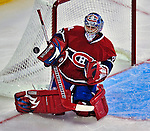 21 September 2009: Montreal Canadiens' goaltender Carey Price makes a blocker save in the second period of a pre-season game against the Pittsburgh Penguins at the Bell Centre in Montreal, Quebec, Canada. The Canadiens edged out the defending Stanley Cup Champions 4-3. Mandatory Credit: Ed Wolfstein Photo