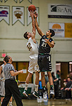 26 January 2014: University of Vermont Catamount Forward Ethan O'Day, a Sophomore from Mansfield, CT, tips off against  Binghamton University Bearcat Forward Nick Madray, a Freshman from Mississauga, Ontario, to start play at Patrick Gymnasium in Burlington, Vermont. The Catamounts defeated the Bearcats 72-39 to notch their 12th win of the season. Mandatory Credit: Ed Wolfstein Photo *** RAW (NEF) Image File Available ***