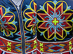 Close up of front and back of Native American Pow Wow Regalia. <br />