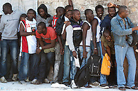 Refugees and illegal immigrants queue for registration papers in Athens. 8-6-12 Each week up to 1,000 people queue at the government facility on Petro Ralli road for up to four days. Only around 20 are issued with papers.