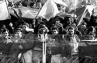 Roma  Campionato di calcio 1985/1986.Stadio Olimpico.Tifosi della Roma in curva sud.Pugno chiuso e saluto fascista.