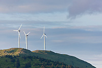 Three wind generators whirl on top of Pillar mountain near the city of Kodiak, Kodiak Island, Alaska.