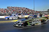 Jul. 28, 2013; Sonoma, CA, USA: NHRA funny car driver Alexis DeJoria (near lane) races alongside Robert Hight during the Sonoma Nationals at Sonoma Raceway. Mandatory Credit: Mark J. Rebilas-