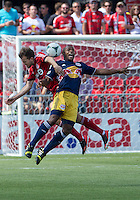 20 July 2013: Toronto FC forward Jeremy Brockie #22 and New York Red Bulls defender Jamison Olave #4 in action during an MLS regular season game between the New York Red Bulls and Toronto FC at BMO Field in Toronto, Ontario Canada.