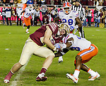 Florida defensive back Chauncey Gardner, Jr. misses a tackle of Florida State tight end Ryan Izzo in the first quarter of an NCAA college football game in Tallahassee, Fla., Saturday, Nov. 26, 2016. (AP Photo/Mark Wallheiser)