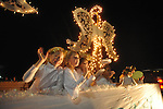 Students wave from the Regents School of Oxford float in the Christmas parade in Oxford, Miss. on Monday, December 3, 2012.