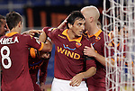 Calcio, Serie A: Roma vs Palermo. Roma, stadio Olimpico, 4 novembre 2012..AS Roma forward Mattia Destro, bottom left, partially hidden, is hugged by teammates after scoring during the Italian Serie A football match between AS Roma and Palermo, at Rome's Olympic stadium, 4 november 2012..UPDATE IMAGES PRESS/Riccardo De Luca