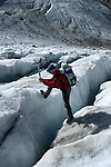 Switzlerland: Hiking the Swiss Glaciers near St. Moritz, taking the Diavolezza Morteratsch hike..Guide Paul Niggs at crevice on Pers Glacier. Model Released..Photo copyright Lee Foster, 510/549-2202, lee@fostertravel.com, www.fostertravel.com..Photo #: swisse11696