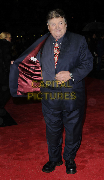 Robbie Coltrane.The 'Great Expectations' closing night gala, the 56th BFI London Film Festival, Odeon Leicster Square cinema, Leicester Square, London, England..October 21st, 2012.full length black blue suit red print tie hand opening lining .CAP/CAN.©Can Nguyen/Capital Pictures.