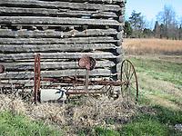 An old harrow left behind an abandoned corn crib.