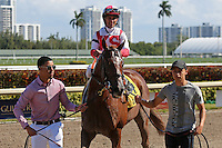 HALLANDALE BEACH, FL - FEBRUARY 04:  Favorable Outcome (KY) #4 with jockey Javier Castellano up,  heads to the winners circle, after winning the Swale Stakes G2  at Gulfstream Park on February 04, 2017 in Hallandale Beach, Florida. (Photo by Liz Lamont/Eclipse Sportswire/Getty Images)
