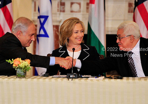 """United States Secretary of State Hillary Rodham Clinton, center, smiles as Prime Minister Benjamin Netanyahu of Israel, left, and Mahmoud Abbas of the Palestinian Authority shake hands following their remarks at the start of the """"Relaunch of Direct Negotiations Between the Israelis and Palestinians"""" in the Benjamin Franklin Room of the U.S. Department of State on Thursday, September 2, 2010.  .Credit: Ron Sachs / CNP.(RESTRICTION: NO New York or New Jersey Newspapers or newspapers within a 75 mile radius of New York City)"""
