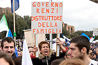 Rome, Italy. 30 January 2016<br /> Pictured: the sign reads: Government Renzi destroyer of family<br /> Thousands of demonstrators take part in the Family Day rally at the Circo Massimo in central Rome  in support of traditional family and to protest against a bill to recognize civil unions, including same-sex ones currently under examination at the Italian Parliament.