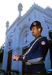 A Pakistani police guard at the All Saints church in Peshawar.