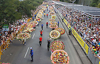 "MEDELLIN, COL AUG 07. Flower growers known as ""silleteros"" carry their floral arrangements during the 59th annual Silleteros parade in Medellin, Colombia, August 7, 2016. (Photo by Fredy Builes/VIEWpress)"