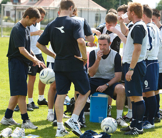David Weir relaxes with a jelly baby after a coaching session under the eye of the SFA examiners at the Inverclyde National Sports Centre in Largs