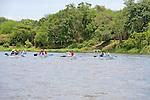 Tourists Canoeing On Zambezi River