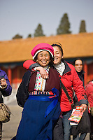 Women from Chinese minority group visit the Forbidden City, Beijing, China