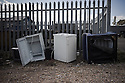 Hastings, UK. 29.09.2012.  Abandoned fridges and an armchiar on the beach at Hastings. Photo credit: Jane Hobson.