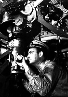 Officer at periscope in control room of submarine.  Ca.  1942.  (Navy)<br /> Exact Date Shot Unknown<br /> NARA FILE #:  080-G-11258<br /> WAR &amp; CONFLICT BOOK #:  944