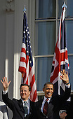 U.S. President Barack Obama (R) and British Prime Minister David Cameron participate in an official arrival ceremony on the South Lawn of the White House March 14, 2012 in Washington, DC. Prime Minister Cameron is on a three-day visit to the U.S. and he is expected to have talks with Obama on the situations in Afghanistan, Syria and Iran. .Credit: Chip Somodevilla / Pool via CNP