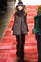 Kate King walks runway in an outfit from the Tommy Hilfiger Fall 2011 Bohemian Prep collection, during Mercedes-Benz Fashion Week Fall 2011.