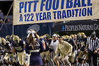 Pitt head coach Todd Graham (yellow jacket) leads his team out onto the field. The Pitt Panthers defeated the USF Bulls 44-17 on September 29, 2011 at Heinz Field in Pittsburgh Pennsylvania.
