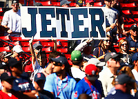 Fans hold up signs during batting practice prior to the final game of Derek Jeter's career against the Boston Red Sox at Fenway Park on September 27, 2014 in Boston, Massachusetts. (Photo by Jared Wickerham for the New York Daily News)