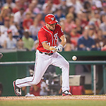 23 July 2016: Washington Nationals starting pitcher Max Scherzer lays down a sacrifice bunt in the 5th inning against the San Diego Padres at Nationals Park in Washington, DC. The Nationals defeated the Padres 3-2 to tie their series at one game apiece. Mandatory Credit: Ed Wolfstein Photo *** RAW (NEF) Image File Available ***