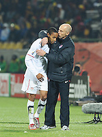 Coach Bob Bradley consoles midfielder Ricardo Clark, after removing him from the match in the 31st minute. Ghana defeated the U.S., 2-1, in extra time to advance to the quarterfinals, Saturday, June 26th, at the 2010 FIFA World Cup in South Africa..