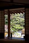 Photo shows the Japanese garden through the window of the tea house inide the grounds of Jomyoji temple in Kamakura, Japan on 24 Jan. 2012. Photographer: Robert Gilhooly