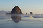 Haystock Rock and jogger at Cannon Beach, OR