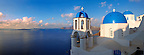 Oia, ( Ia ) Santorini - Blue domed Byzantine Orthodox churches, - Greek Cyclades islands