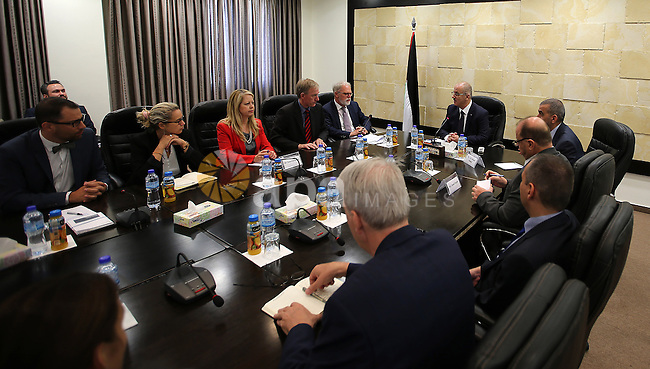 Palestinian Prime Minister Rami Hamdallah meets with a delegation from the Federal Academy for Security Policy in Germany , in the West Bank city of Ramallah, on June  2, 2016. Photo by Prime Minister Office