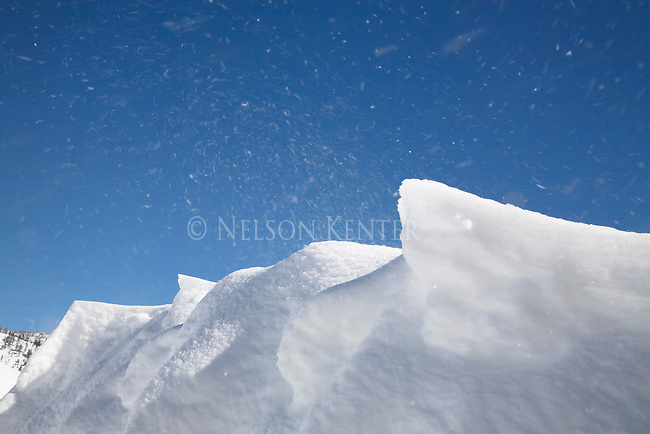 Snow banks sculpted by blowing wind.
