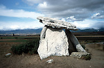 Dolmen of Sorginetxe with Sierra de Aitzkorri in background<br />