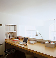 The home office overlooks the main living area of the loft